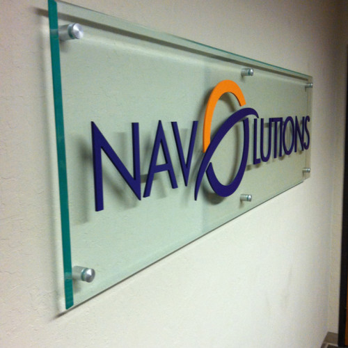 Lobby signage on glass installed in Pleasanton for Navolutions