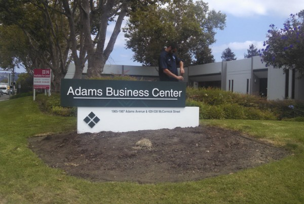 Bennett Graphics installing a monument Sign at Adams Business Center in San Leandro