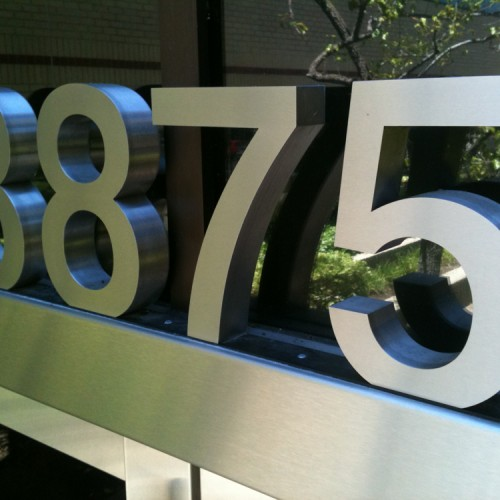 T. Bennett Services, LLC made Channel Letters address for Harsch building