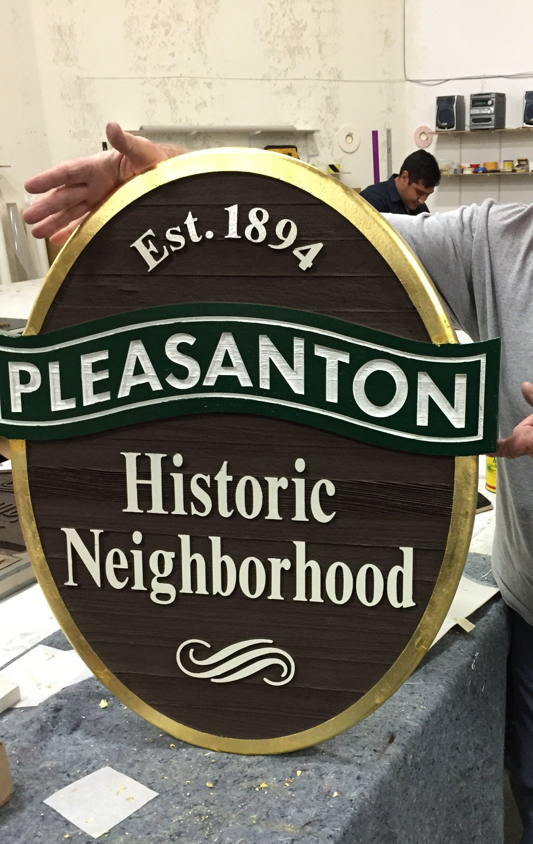 Sandblasted wood goldleaf sign for Pleasanton, CA
