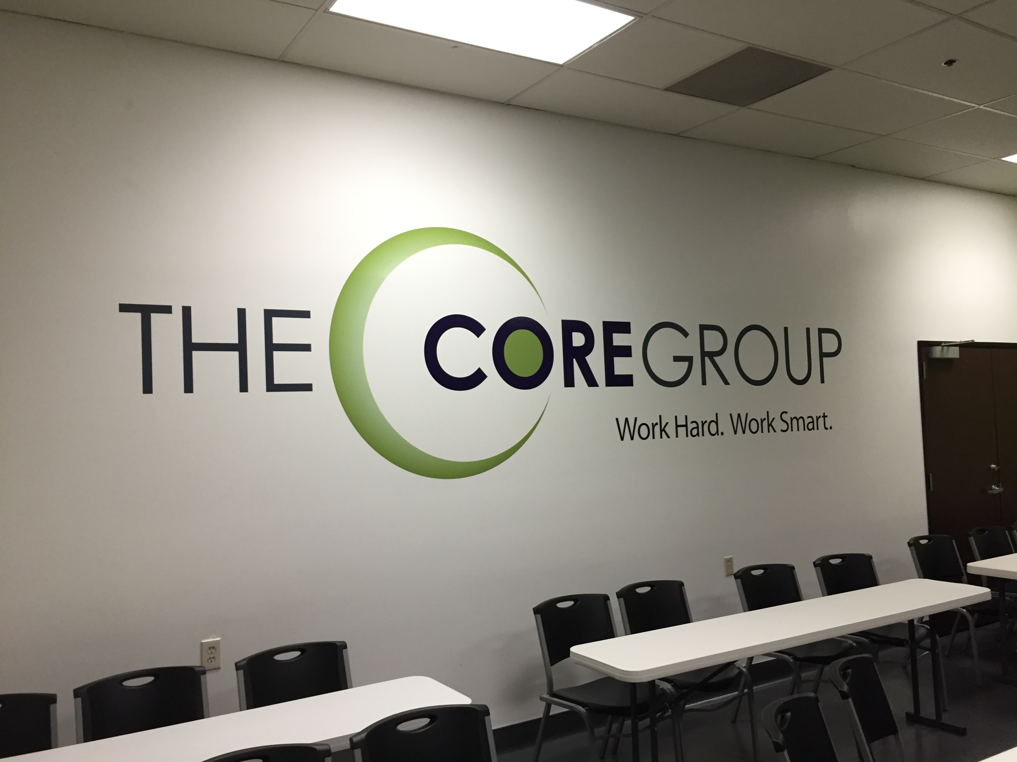 finished vinyl wall logo for the core group